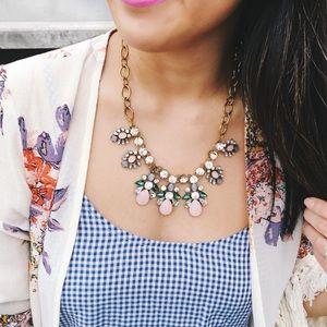 Pastel pink droplet necklace.
